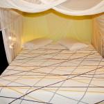Nosso quarto, com ar e mosquiteiro, e uma super cama gostosa